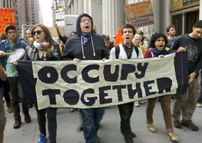 Participants in the occupation of Wall Street march toward the Brooklyn Bridge